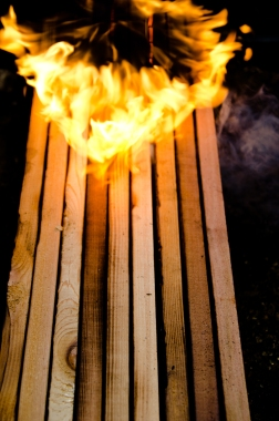 Charring the Matchbox's shou sugi ban siding.