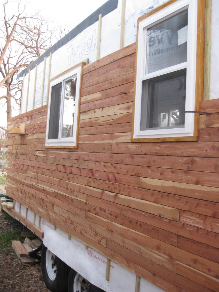 Cedar rain screen siding going up