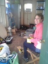 My mom helping me organize all my building supplies