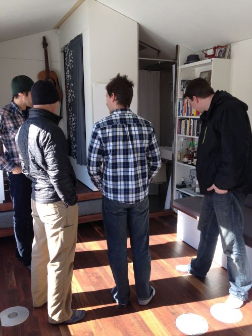 Deek of Relax Shacks and Art of Tumbleweed Tiny Houses getting a tour by Brian of the Minim House